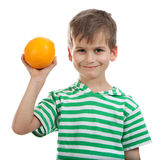 Boy holding oranges Stock Photo