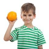Boy holding oranges Stock Photo