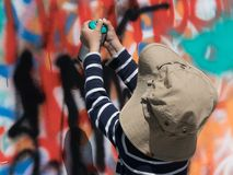 Boy holding paint spray painting graffiti Royalty Free Stock Images