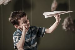 Boy holding paper airplane Stock Photography