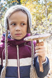 Boy holding parasol mushroom outdoors Stock Photo