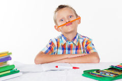 Boy is holding pencil under nose Stock Photos