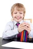 Boy holding pencils Stock Photo
