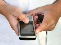 Boy holding  phone Stock Images