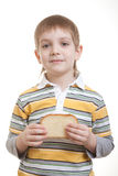 Boy holding piece of bread Royalty Free Stock Photos