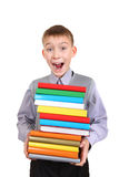 Boy holding Pile of the Books. Surprised Boy holding Pile of the Books Isolated on the White Background Royalty Free Stock Photography