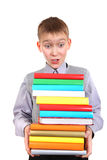 Boy holding Pile of the Books Stock Photos