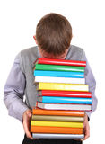 Boy holding Pile of the Books Royalty Free Stock Photos