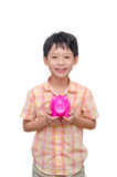 Boy holding pink piggy bank over white Royalty Free Stock Photography
