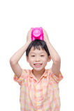 Boy holding pink piggy bank over white Royalty Free Stock Photos