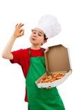 Boy holding pizza showing OK royalty free stock image