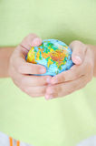 Boy holding the planet earth Royalty Free Stock Images