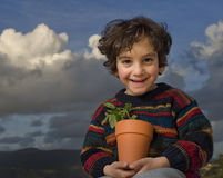 Boy holding plant Royalty Free Stock Photo