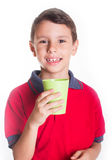 Boy holding plastic cup Royalty Free Stock Images