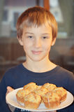 Boy Holding Plate of Muffins Stock Images