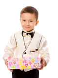 Boy holding present royalty free stock image