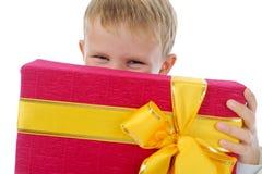 Boy holding present box stock photography