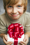 Boy holding present box Royalty Free Stock Image