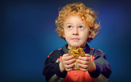 Boy  holding a present box Stock Image