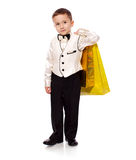Boy holding presents Stock Images