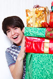 Boy holding presents Stock Photography
