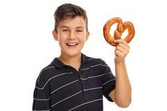 Boy holding a pretzel Royalty Free Stock Photo