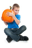 Boy holding pumpkin Royalty Free Stock Images