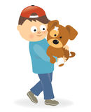 Boy holding a puppy with bandaged paw Royalty Free Stock Photography