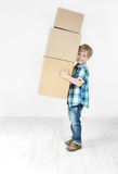 Boy holding pyramid of carton boxes. Packing up Stock Photography