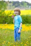 Boy Holding Red Apple in the Garden Stock Image