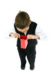 Boy holding red bag Stock Images