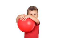 Boy holding a red ball. Cute little boy holding a red ball isolated on white background Stock Photography