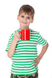 Boy holding a red cup Royalty Free Stock Photos
