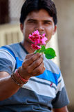 Boy holding red flower in his hand Royalty Free Stock Photography