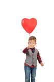 Boy holding a red heart shaped Royalty Free Stock Photos