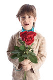 Boy Holding Red Roses Royalty Free Stock Photos