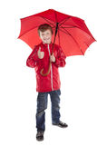 Boy holding red umbrella over white background royalty free stock photography