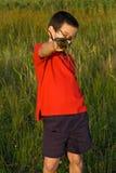 Boy holding reeds Stock Photo