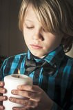 Boy holding a religious candle Royalty Free Stock Image
