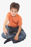 A boy holding a remote Royalty Free Stock Image