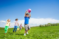 Boy holding rocket carton toy and children running Royalty Free Stock Image