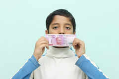 Boy holding 2000 rupee new Indian money in his hand. Stock Image