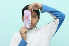 Boy holding 2000 rupee new Indian money in his hand. Stock Photo
