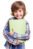 Boy holding school books Royalty Free Stock Image