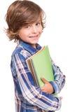 Boy holding school books Stock Image