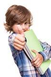 Boy holding school books Stock Photo