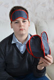 Boy holding a several masks for sleep Royalty Free Stock Images