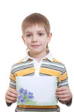 Boy holding sheet of paper with blue flowers Royalty Free Stock Photo
