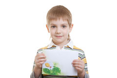 Boy holding sheet of paper with flower Royalty Free Stock Images