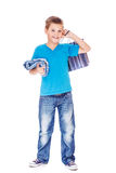 Boy holding shopping bag Stock Images